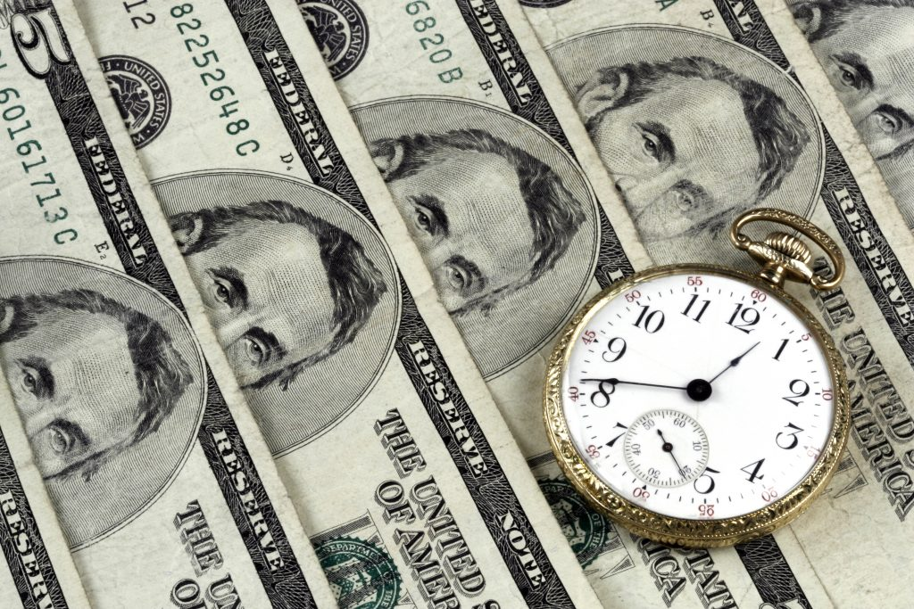 Money and Time - Dreamstime photo by Alan Crosthwaite